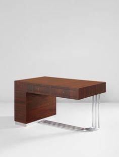 AGNOLDOMENICO PICA  Desk  circa 1933  Caucasian walnut-veneered wood, aluminum, chromium-plated steel.  31 1/2 x 55 1/4 x 33 1/4 in. (80 x 140.3 x 84.5 cm)  Executed by Daniele Tagliabue, Cantù, Italy.
