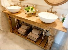 Double vanity with vessel sinks, open shelves, metal baskets, coastal/beach inspired bathroom...