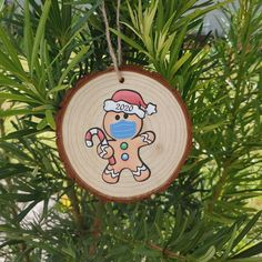 🎄Wood Slice Ornaments/ 2020 Face Mask Gingerbread Man Ornament. This is the year to remember! Make sure you grab your 2020 Christmas Ornament! Wooden ornaments bring a natural elegance to your Christmas tree. Wood Circles are made of natural pine wood with barks. And some wood bark may fall Diy Christmas Mugs, Christmas Craft Fair, Christmas Rock, Wooden Christmas Ornaments, Painted Ornaments, Christmas Decorations, Gingerbread Ornaments, Gingerbread Man, Wood Bark