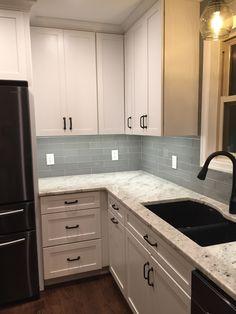 Colonial White Granite With Gray Glass Backsplash