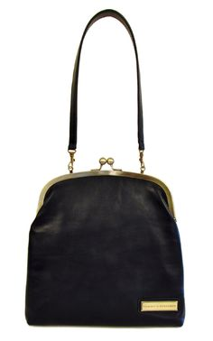 love the vintage style clasp, plus you can fold over and use as evening clutch