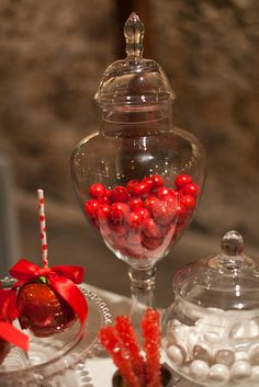 Red and white candy jars at a Valentines Day Party!  See more party ideas at CatchMyParty.com!  #partyideas #valentine