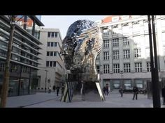 This giant, moving Franz Kafka head stares at City Hall in Prague - YouTube