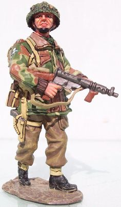 World War II British Army MG011 British Airborne Lt. with Sten Gun - Made by King and Country Military Miniatures and Models. Factory made, hand assembled, painted and boxed in a padded decorative box. Excellent gift for the enthusiast.