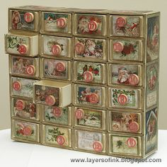 Layers of ink - Advent Calendar Tutorial, made with Eileen Hulls Sizzix Candy Drawer die and Tim Holtz Idea-ology paper and game pieces. All the little drawers open. Matchbox Crafts, Matchbox Art, Altered Boxes, Altered Art, Christmas Projects, Christmas Holidays, Advent Calenders, Countdown Calendar, Paper Crafts