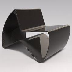 British designer Kris Lamba has folded a 20-metre-long piece of carbon fibre into a chair