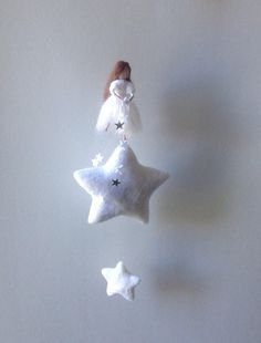 A little fairy on a star, throwing stars on you. She is made with pipecleaner and merino wool, her wings are made of a non woven fabric. The stars are needle felted and made of merino wool. Total length of the mobile from top fairy untill bottom lowest star: 29cm / 11inches Custom