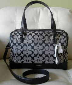 The Coach Park Signature KT Triple Zipper Satchel in Black is one of Coach's most Sophisticated Handbags. Do not let its' Luxurious Look, Silver Accents, and Fine Craftsmanship fool you it is More than Capable of Holding all of your Personal Essentials. It just does so with Elegant Style. Very Ro...