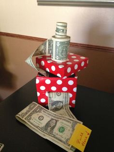Creative way to give cash as a gift. Tape dollars together, then roll and place in box. Cut slit in box with tab sticking out.