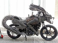 Remarkably an artist has made it out of spare parts this awesome alien motorbike The artist used recycled materials from old cars and bicycles to create a monster machine which is sculpted to look like a beast. Roongrojna Sangwongprisarn created it out of spare parts in his workshop in Thailand. He has four shops across the country – named the Ko Art Shop & exports his creations to clients all over the world.