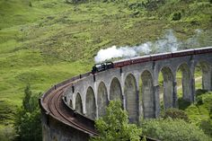 Jacobite steam train on Glenfinnan Viaduct from Fort William to Mallaig. The viaduct is just an hour drive from Fort Augustus!