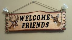 """22"""" x 6 4/3"""" Rustic Log Slab sign with a buck on one side and a doe on the other.      The letters """"Welcome Friends"""" is routed into the wood and painted with black acrylic paint.      The animals are burnt in and painted.      The sign is finished with several coats of exterior vanish to protect it from the elements when hung outside.    The sign is made from 1st cut hemlock slab I get from a local Amish saw mill scrap pile.     This sign is ready to ship and can be hung inside our outside…"""