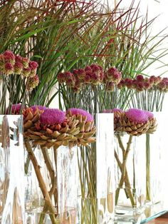 Simple and clean floral design concept in simple purple artichokes and grass <3