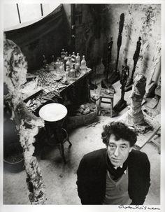 The artist Alberto Giacometti in his studio by Robert Doisneau