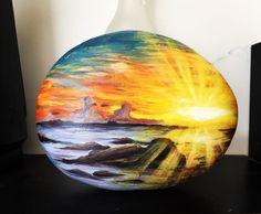 Blazing sunset painted rock.