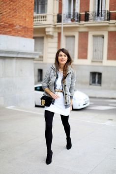 Winter Outfits - how to style tights: belted white body con dress worn with a gray knit jacket + dense black tights and pointy ankle boots