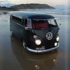 Almost hard to imagine it getting any better, surf, VW Van...just need the girl.
