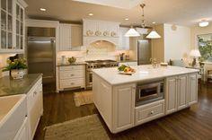 traditional-kitchen-white-cabinets-ceiling-lighting-range-hood-stainless-steel-appliances-kitchen-ledge.jpg 639×425 pixels