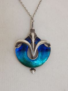 Liberty & Co. silver pendant, c.1900. Enamelled silver. Jewelry inspiration.