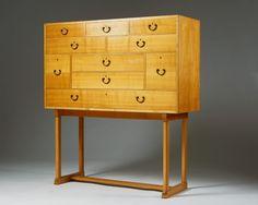 Cabinet number 1052 designed by Josef Frank for Svenskt Tenn, Sweden, 1940 - Cherrywood with patinated brass handles - H: 132 cm, L: 120 cm, D: 40 cm