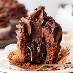 Need a special sweet treat for you Valentine? Look no further. These triple chocolate cupcakes are insanely rich and delicious. These triple chocolate cupcakes are ridiculously indulgent, easy to ma Chocolate Fudge Sauce, Best Chocolate Desserts, Chocolate Frosting Recipes, Chocolate Buttercream, Buttercream Frosting, Chocolate Fudge Cupcakes, Gluten Free Chocolate Cupcakes, Easy Cupcake Recipes, Easy Desserts