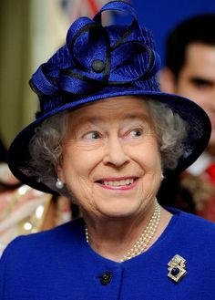 Beautiful hat, I love the look on the Queen's face