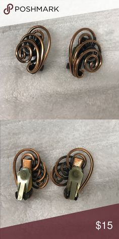 """Vintage copper clip on earrings Really cool vintage air rings made out of copper wire. They are clip on.  Unsigned 1.25"""" long Jewelry Earrings"""