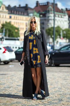 Orange prints and a black duster.