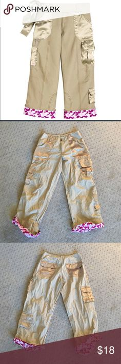 American girl girls cargo pants From 2004 dress like your doll collection. Beige cargo pants. Pink camouflage cuffs. Doll outfit not included, this is just the girls pants, belt MIA American girl Bottoms