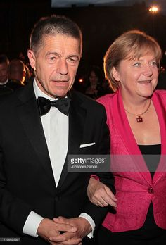 German chancellor Angela Merkel (R) and her husband Joachim Sauer arrive for the reception of the Bavarian state governor after the Bayreuth festival 2011 premiere on July 25, 2011 in Bayreuth, Germany.