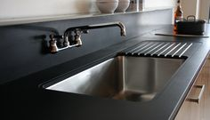 Another view of the integrated drainboard.  Maybe this could be paired in paperstone with deer isle granite on other surfaces.