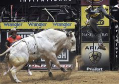 Kody Lostroh gets tossed in the air by Gator Bend during the Championship Round of the Ty Murray Invitational event in Albuquerque, New Mexico   PBR