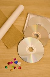 "Activities: Craft a Homemade Kaleidoscope...What a great idea...maybe for the last week of school.  This would keep the students excited about creating a really neat project to take home!  Probably a 3rd,4th, or 5th  grade activity...All heavy duty ""cutting"" would most likely be done for the kids, due to the use of sharp blades...But, WHAT FUN!...They would love this!"