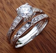 We designed and hand make this ring. The center diamond is 5.6mm round and weight is .70cts the clarity is SI2 and F-G color range. $2250