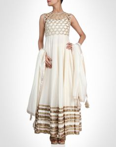 Nothing like this white anarkali with gold cutwork crop jacket.SHOP NOW@ www.kimaya.in