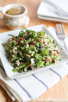 ¾ C Toasted Pecans, cooled and rough-chopped 1 C Short Grain Brown Rice 2 C Water 1 C Green Bell Pepper, diced (1 large) ¾ C Black Olive, sliced ¼ C Purple Onion, small dice 1½ C Baby Spinach Leaves, ribboned ½ C Mediterranean Feta Cheese, crumbled (optional) ¼ C Parsley, chopped For the Dressing: 2 Tbs Lemon Juice ⅛ C Extra Virgin Olive Oil Fresh Ground Pepper to taste ¼ tsp Sea Salt