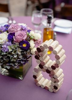 Photographer: Viera Photographics; Unique purple wedding reception table number idea