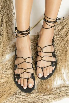 """Explore our collection of Women's leather sandals, meet """"Danae"""" & """"Gogo"""" in Black (also available in many colors) and add a boho-chic touch to your look. These amazing gadiators are great for grounding your summer outfit. Elegant yet comfy and so lightweight that they feel as if you're wearing virtually nothing at all. Greek Chic Handmades sandals are handcrafted in Athens, Greece and designed to accompany you everywhere. Find your perfect pair of beautiful Greek sandals!"""