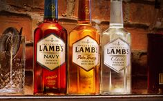 Lamb's: A Family of Fine Smooth and Refined Rums — The Dieline - Branding & Packaging Design Label Design, Package Design, Branding Design, Alcohol Bottles, Glass Bottles, Label Shapes, Dark Spirit, Drink Labels, Hooch
