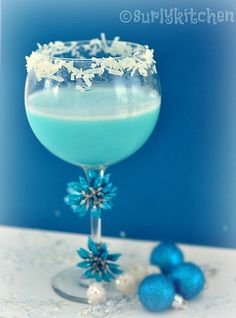 Coco Snowball: Vodka, Malibu Rum, Coco Lopez (cream of coconut), Blue Curacao