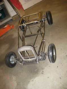 Go kart sized hot rod chassis.