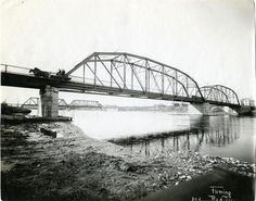 The Gaetz Ave Traffic bridge and the CPR bridge, 1912. Photo is looking NW from the east side of the traffic bridge. Red Deer, AB