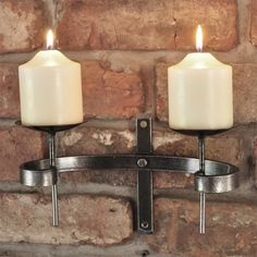 Hand Forged Traditional Wall Sconce - This Hand Forged Traditional Wall Sconce is a great way to give a room a traditional touch. The texture of the steel is beautifully highlighted to enhance the look of this sconce, it's simple but elegant design is guaranteed to be a talking point.