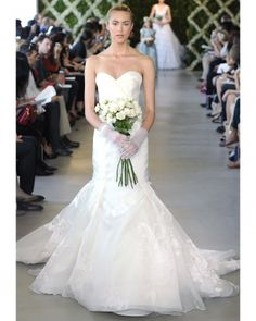With tulle capes, organza trains and crop tops, de la Renta's collection truly signaled an evolution in bridal fashion. Bridal Dresses, Wedding Gowns, Bridesmaid Dresses, Wedding Bells, Bridal Fashion Week, Gorgeous Wedding Dress, Wedding Styles, Wedding Ideas, Wedding Stuff