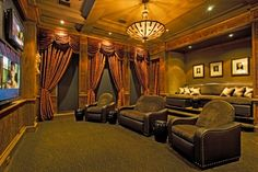 Old World theater room, like the sofa in back, interesting concept.