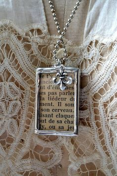 soldered necklace with french bookpage and fleur de lis