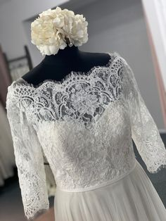 This A-line wedding dress features a bateau off-the-shoulder neckline, corded Alencon lace bodice and sleeves, soft netting skirt, and grosgrain ribbon at the waist. Lace Bodice, Bridal Boutique, Grosgrain Ribbon, Townhouse, Off The Shoulder, Neckline, Wedding Dresses, Skirts, Sleeves