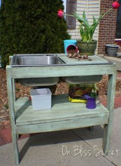 Potting stand  made from a sink from ReStore.  Could also fill sink with ice/drinks for an outdoor party.
