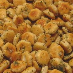 Ranch Oyster Cracker Snacks - Mix 1-oz pkg ranch dressing mix, 1/4 c. oil, 1 tsp dried dill weed, 1/2 tsp garlic powder, and salt to taste. Stir in 1 box/bag oyster crackers. Bake on large cookie sheet at 250° for 15 minutes, stirring every 5 minutes or so. Cool. Store in covered container.