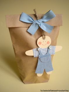 Many ways to adapt this for xmas time gifts. Gingerbread man/girl santa snowman elf etc Baby Gift Wrapping, Gift Wraping, Creative Gift Wrapping, Wrapping Ideas, Creative Gifts, Paper Gift Bags, Paper Gifts, Pretty Packaging, Gift Packaging